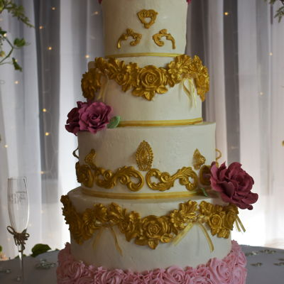 Rose And Gold Wedding Cake Cake I made for my friend's daughter's wedding.Buttercream with gumpaste swags, scrolls and roses.