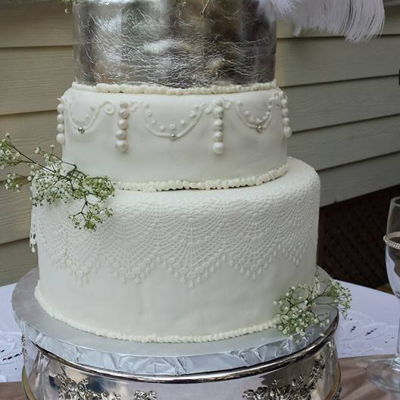 Silver Evening A four tiered cake with edible lace, silver leaf and feathers