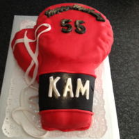 Boxing Glove Chocolate cake covered in fondant for an ex boxer and gym instructor 's Birthday