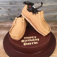 Clarks Shoe Cake This 3D Clarks shoe and scorpion cake was made for Canadian rapper Snow. You can watch the time lapse video of it's creation at -