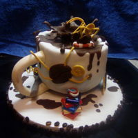 Cup Of Coffee For The Birthday inside chocolate cream with chocolate biscuit.