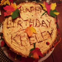 Fall Birthday All edible (except the wood base). Leaves are chocolate. Chocolate cake with peanut butter frosting.