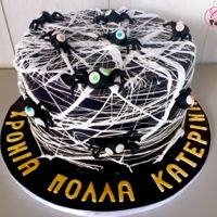 Halloween Spiderweb Cake Chocolate cake with a cookies & cream buttercream filling, covered in black fondant, marshmallow spiderweb and spiders made from...