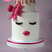 Lips And Lashes Cake Lips and Lashes cake with a pink bow and gold drip. It was my birthday this week and I wanted a cake that was fun, modern and pink :) Find...