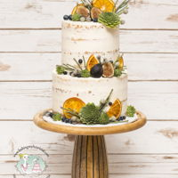 Naked Cake Naked wedding cake adorned with home made dried oranges.