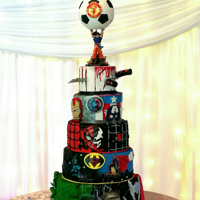 Superhero Wedding Cake 5 tiers of eggless lindt chocolate and vanilla caramel cake!How cool! The topper is a Goku holding up a soccerball with a little replica of...