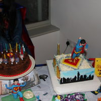 Superman Cake White chocolate mud cake with white choice frosting. I used a steel frame to mould Superman onto