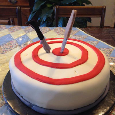 On Target These knives are right On Target embedded in this rich marble cake covered in buttercream and fondant.