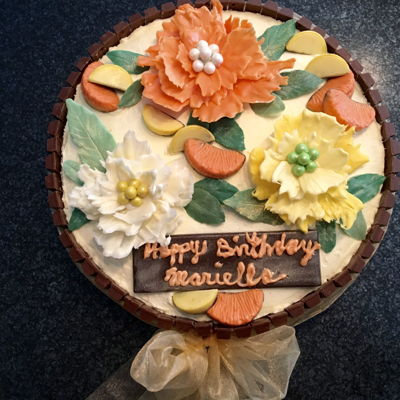 Orange Birthday Cake With Chocolate Flowers Orange cake with orange lemon cream filling , orange buttercream frosting . Various colored white chocolate flowers and leaves . Mini...