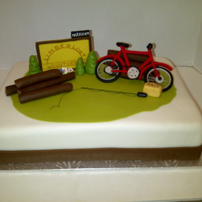 Retirement Cake Most difficult modelling ever - a bicycle.Chocolate slab cake, fondant covered.Modelled deco's.