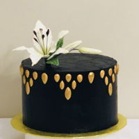 25Th Birthday Black SMB cake with fondant gem details. Dusted and painted in gold. Gumpaste Tiger Lily. Birthday girls favorite flower.