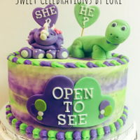 Dinosaur Gender Reveal Cake A unique gender reveal cake - cute dinosaurs, purple for girl and green for boy.
