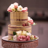 Drip Cake With Fresh Flowers A sweet little two tier drip cake with fresh flowers for a small, intimate wedding