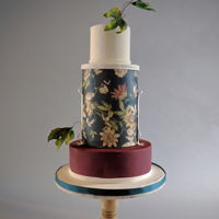 Fall Wedding Cake A bit of a moody cake, inspired by wallpaper. (True fact!) I added some fall sugar leaves to capture the changing of the season. The Satin...