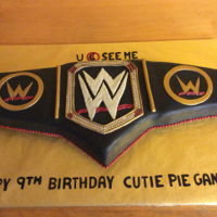 Gannon's Icing Smiles Icing Smiles cake I made for a beautiful little boy. He loves John Cena so I made him a championship wrestling belt.