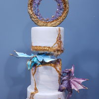 Kintsugi Geode Style Wedding Cake This cake was for a 20th wedding anniversary. The dragons were made from modeling chocolate the crystals are made from sugar and the cake...