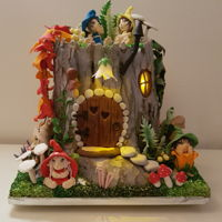 Old Stump Secret-Fairy Tale I made this cake for my daughter's birthday. She adores elves and fairy creatures. Who doesn't? The realistic stump is...
