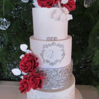 Red Roses For Valentina 4 tier cake designed for Valentina´s 15th birthday party . Romantic and glamorous to match the whole decoration!