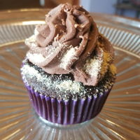Smores Cupcake Marshmello filled chocolate cupcakes with a gram cracker base and chocolate buttercream frosting.