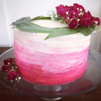 Textured Ombre Fuschia Buttercream Cake A little textured ombre cake with fresh flowers on top!