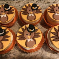 Turkey Pilgrim Cupcakes Turkey pilgrim cupcakes made with fondant.