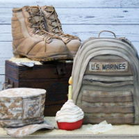 United States Marine Corps Birthday Cake Carved boots, rucksack, footlocker and hat cakes. Cupcake is rice crispie treat and dog tags are modeling paste. Cake served approximately...