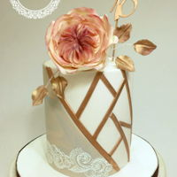 18 Th Birthday Cake Doble barrel cake with marbled details and geometric design in gold rose. Gumpaste English rose on top.