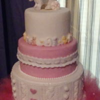 Baby Girl 2nd of 4 cakes for baby event.......3 tiers, top tier covered in white fondant with sugar bunny topper surrounded by sugar baby item border...