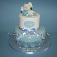 Baptism Cake Baby Elephant Baby baptism cake. The topper reproduces a tender elephant, a subject chosen by the mother as a wedding favor for the event