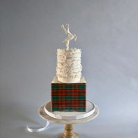 Christmas Cake decked out in wafer paper plaid, gum paste ruffles and a leaping deer!Happy Holidays, everyone!!!
