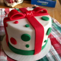 Christmas Cake This is a 6 inch round of chocolate with chocolate ganache filling and American buttercream icing. It is covered and decorated in fondant....