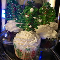 Christmas Tree Cupcakes Cupcakes with candy melt and pretzel Christmas trees.