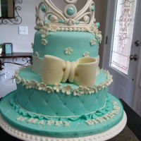 Cinderella Princess Cake Vanilla and chocolate cake in marshmallow fondant and gumpaste crowd , bow and flowers.