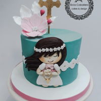 Communion Cake 2d little girl on a beautiful acquamarine colour and a gumpaste cosmos on top to celebrate this communion.