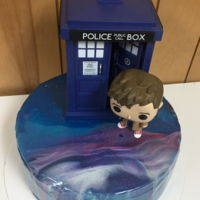 Doctor Who Galaxy Mirror Glaze White chocolate mirror glaze poured over a red velvet cake with buttercream icing.