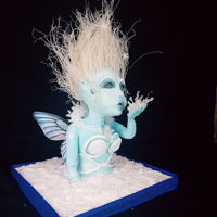 Frost Fairy Chocolate sculpture all edible. Hair is rice noodles the ice is isomalt, her snowflakes and snow is wafer paper