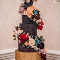Glitter And Gold This 7 tier cake was created for a New Year's Eve wedding in Occoquan Virginia. The cake features 5 real tiers and 2 faux separator...
