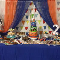 Goofy Sweet Table 3 tier cake, cupcakes big and small, cakepops and caramel wrapped pretzels