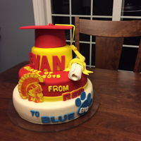 Graduation Cake THIS IS A CAKE THAT I MADE FOR MY SON'S HIGH SCHOOL GRADUATION. CAKE IS VANILLA WITH VANILLA BUTTERCREAM. CAKE LAYERS ARE COVERED WITH...