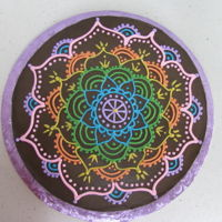 Mandala rainbow mandala on chocolate frosting