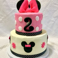Minnie Mouse Chocolate cake with chocolate buttercream filling, vanilla buttercream and fondant accents.