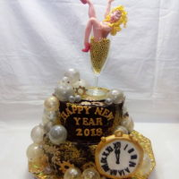 New Year Eve Cake bodom: forest berry cake with creme cheesetop: cirton mousseLady: fondant