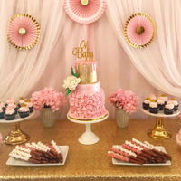 Pink And Gold Sweet Table Pink and gold sweet table for a baby shower cake, cupcakes big and small, cakepops and caramel wrapped pretzels