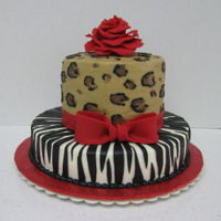 Red Rose, Leopard rose and ribbon fondant, all else is buttercream