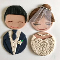 Wedding Cupcakes cupcake toppers to resemble bride and groom atop a cupcake tower