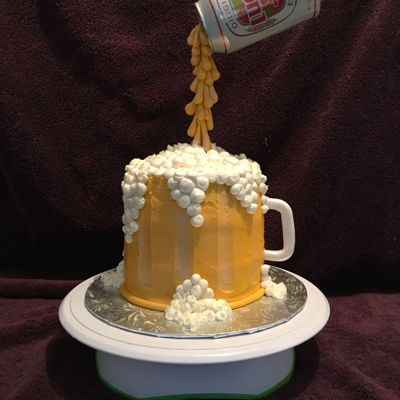 "Beer Pouring Cake This cake is made with 3, 6"" rounds covered in buttercup yellow icing. A dowel was placed in the middle to hold up the beer can..."