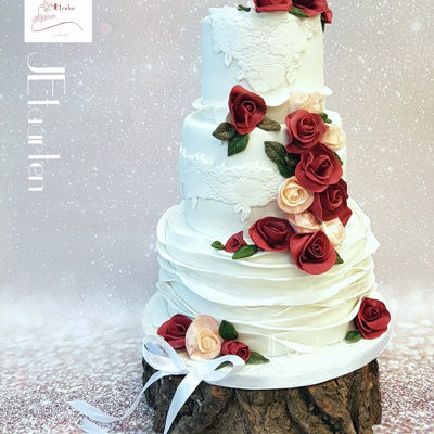 Weddingcake With Burgundy And Peach Roses