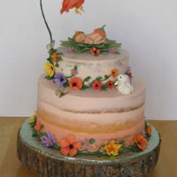 Baby Shower gumpaste baby in flower on semi naked cake
