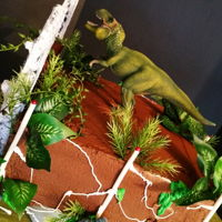 "Jurassic These are some of my favorite cakes. Kaylynn's banner is made of cookies and the gates are made of gumpaste ""painted"" with..."