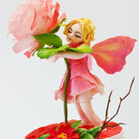Rose Fairy The little Fairy love roses..She feeds them with dew drops and hugs them every morning.